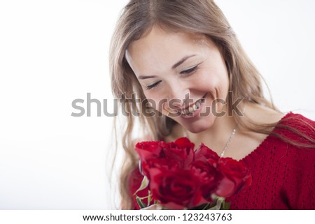 Gorgeous latin woman with a flower bouquet - stock photo
