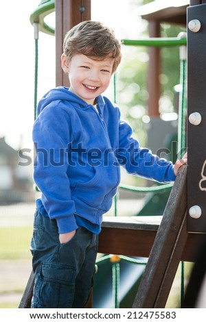 Gorgeous little boy playing in play ground. - stock photo