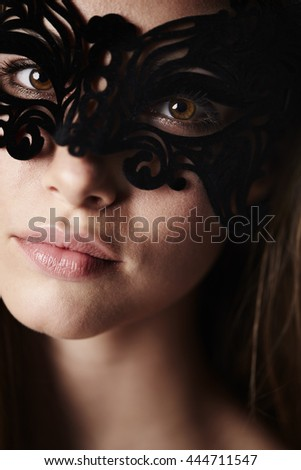 Gorgeous masked young woman, portrait - stock photo