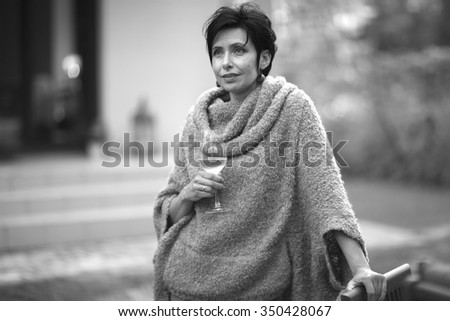 Gorgeous middle age woman with a glass of champagne, monochrome  - stock photo