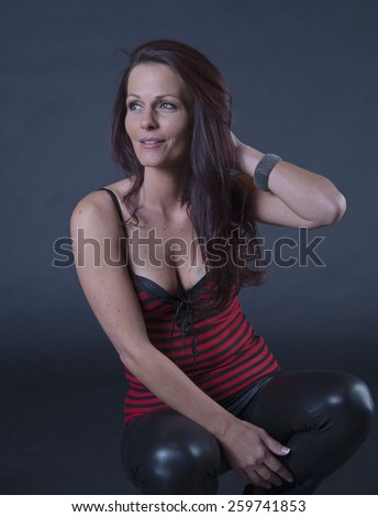 Gorgeous middle aged model kneeling - stock photo