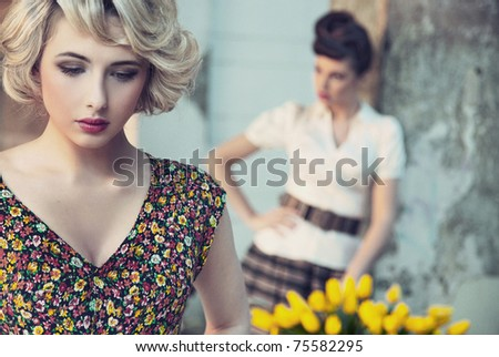 Gorgeous portrait of a two beautiful ladies - stock photo