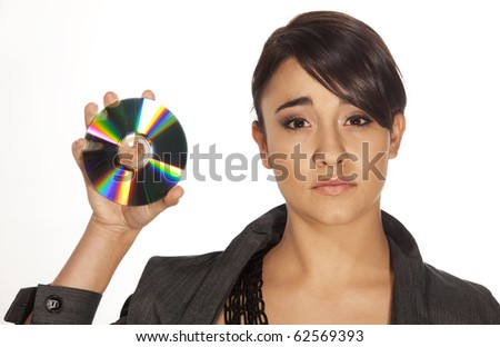 Gorgeous professional looking woman holding up a cd on white background. - stock photo