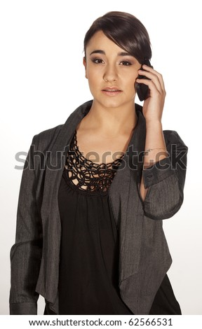 Gorgeous professional woman speaking on her mobile phone. - stock photo