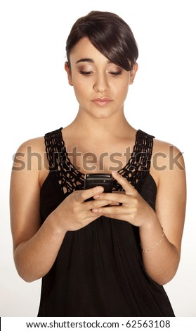 Gorgeous professional woman typing a text sms message on her mobile phone on a white background. - stock photo