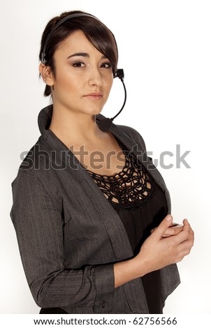 Gorgeous professional woman with a telephone headset on white background. - stock photo