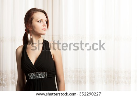 Gorgeous red hair girl pondering - stock photo
