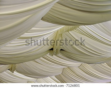 Gorgeous silk canopy for outdoor wedding - stock photo