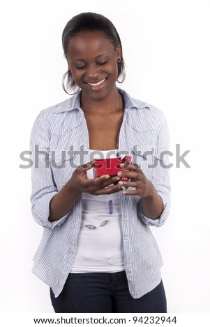 Gorgeous South African woman holding a gift box. - stock photo