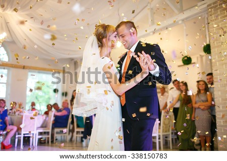 gorgeous stylish happy bride and groom performing their emotional first dance, wedding in a restaurant - stock photo