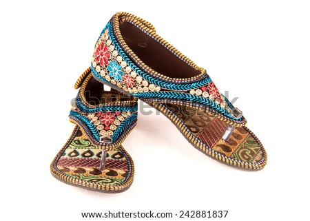 Gorgeous stylish women footwear of ethnic design from India - stock photo