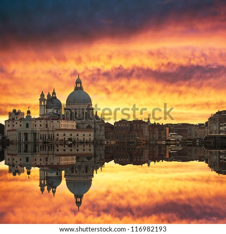 Gorgeous sunset over Grand Canal and Basilica Santa Maria della Salute with beautiful reflections, Venice, Italy - stock photo