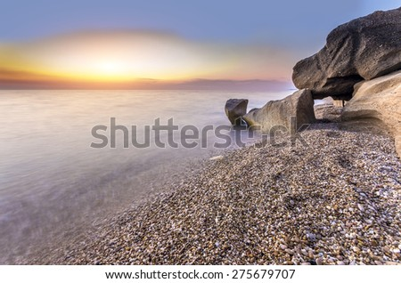 gorgeous sunset over the calm silky ocean surface - stock photo