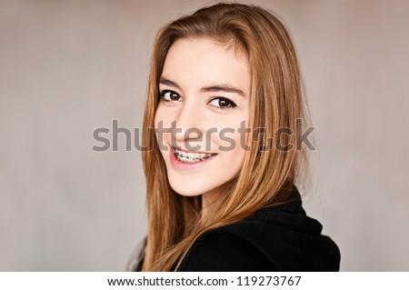 gorgeous teenage girl wearing braces - stock photo