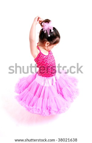 gorgeous toddler girl dancing in a pretty skirt - stock photo