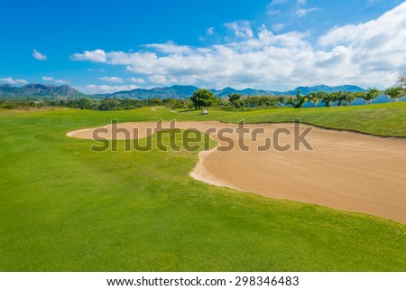 Gorgeous view at the beautiful golf course with sand bunkers. - stock photo