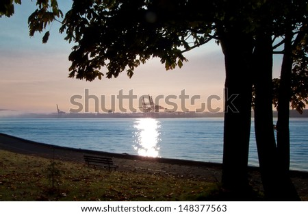 Gorgeous view at the port from the park sea walk side at sunset, sunrise time. Stanley Park, Vancouver, Canada. - stock photo
