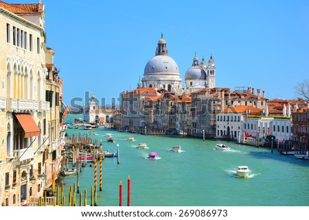 Gorgeous view of boats on the Grand Canal with basilica Santa Maria della Salute, Venice, Italy - stock photo