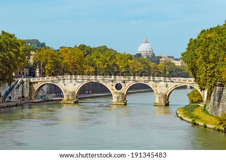 gorgeous view of Sisto footbridge over Tiber river with Saint Peter's Dome at distance in Rome, Italy - stock photo