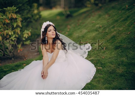 gorgeous wedding and beautiful bride of young people in the summer - stock photo