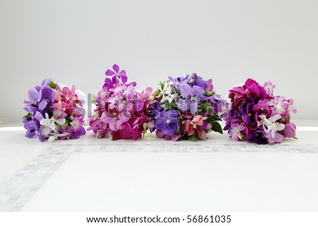 Gorgeous wedding bouquets made from bright orchids and tropical flowers. - stock photo