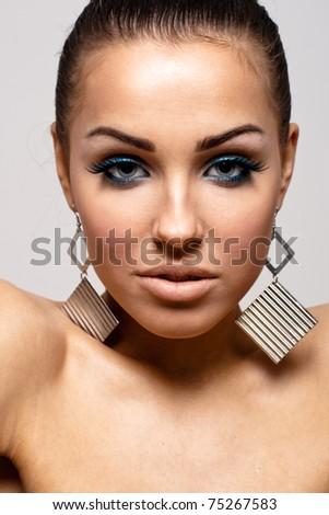 Gorgeous woman in big earrings - stock photo