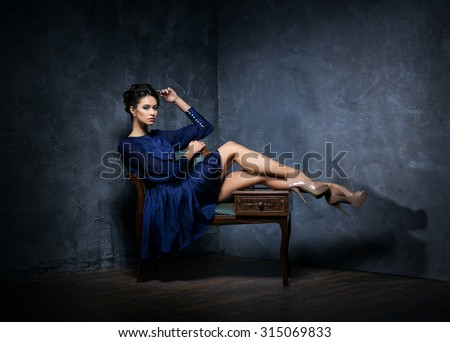 Gorgeous woman in vintage clothes over retro background - stock photo
