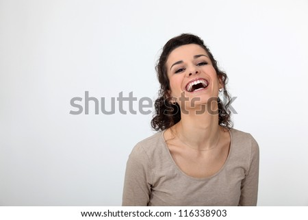 Gorgeous woman laughing out loud - stock photo