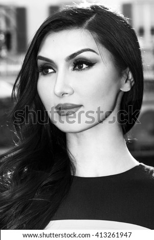 Gorgeous woman portrait smiling and looking aside black and white - stock photo