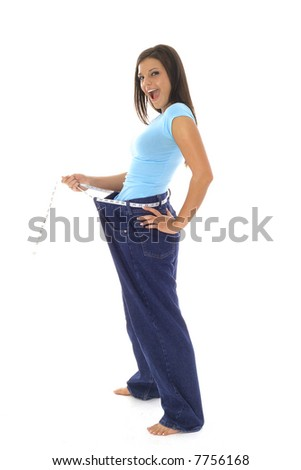 gorgeous woman showing off her weight loss in jeans - stock photo