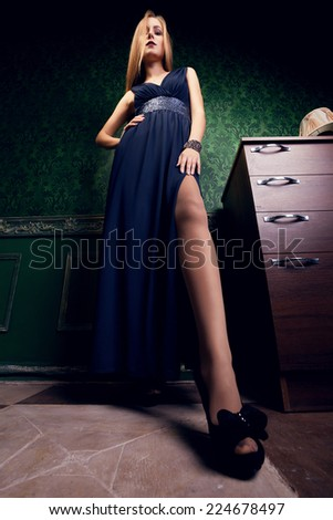 Gorgeous woman with exagerated long legs in vintage interior in night dress. Fashion and glamour. Sensuality. Sexy. Fashionable diva - stock photo