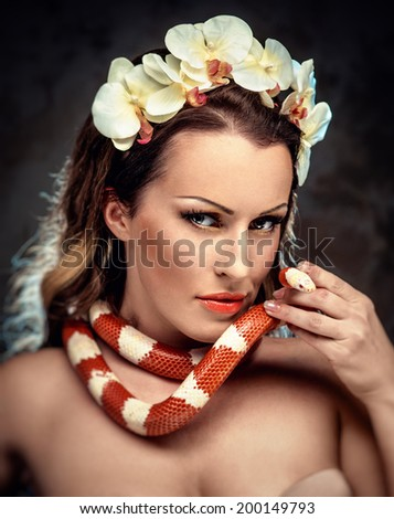 Gorgeous woman with snake - stock photo