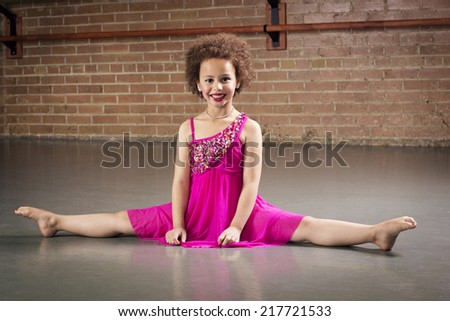 Gorgeous young ballerina at a dance studio - stock photo