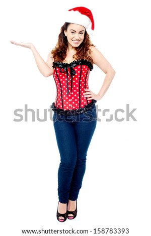 Gorgeous young beauty presenting something - stock photo