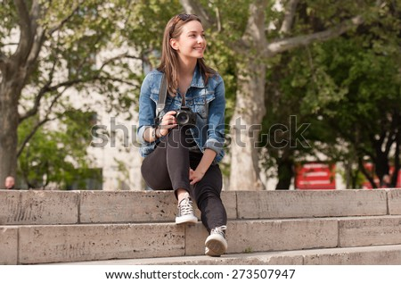 Gorgeous young brunette woman having photography fun. - stock photo