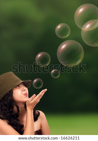 gorgeous young girl with soap bubbles outdoor - stock photo