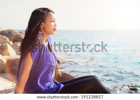 Gorgeous young lady relaxing near the water - stock photo