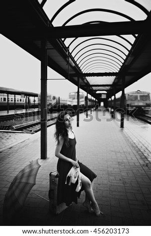 gorgeous young  lady spends time at the station - stock photo