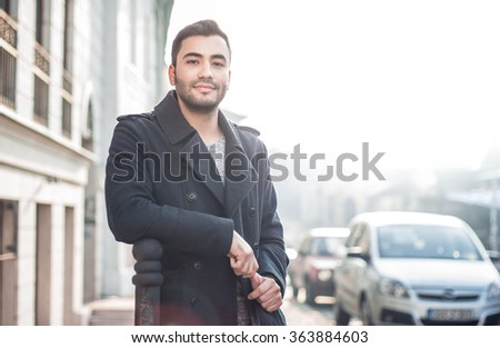 Gorgeous young man looking, outdoors. Handsome beautiful guy posing, outside. Urban scene. Copyspace - stock photo