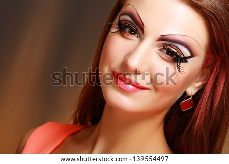 Gorgeous Young model beautiful women with perfect art make up and long false eyelashes - stock photo