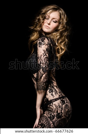 gorgeous young model in lace dress dancing, over black - stock photo