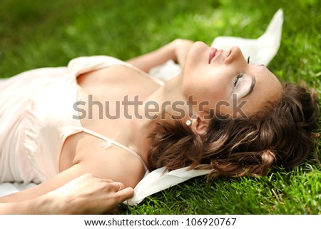 Gorgeous young pretty woman relaxing in spring park - stock photo