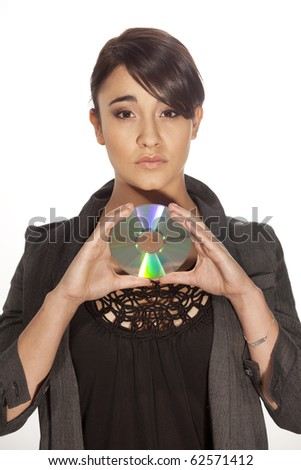 Gorgeous young professional woman holding a cd on white background. - stock photo