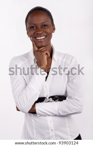 Gorgeous young South African woman in corporate wear, smiling at the camera on white background. - stock photo