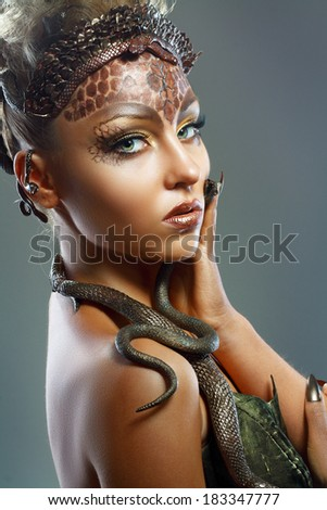 Gorgon medusa. Young woman with creative fantasy hairstyle and make up - stock photo