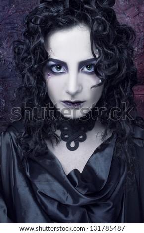 Gorgon. Young woman in dark dramatic image. - stock photo