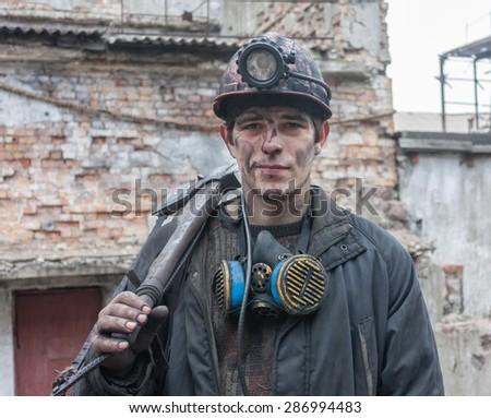 Gorlovka, Ukraine - February 26, 2014: Miner mine named Kalinin after work shift - stock photo