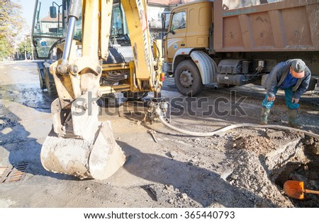Gorna Oryahovitsa - November 5: Repair of urban water and sewerage - stages. Pumping of water from a broken pipe on November 5, 2015, Gorna Oryahovitsa, Bulgaria - stock photo