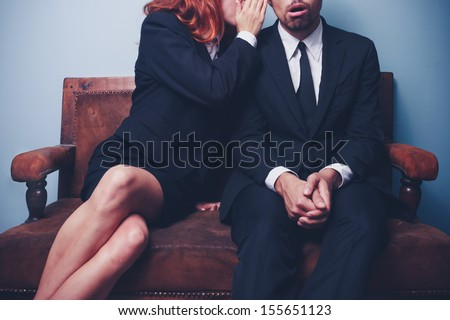 Gossip in the office lobby - stock photo