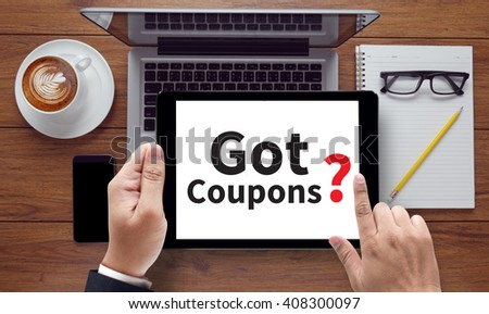 Got Coupons? , on the tablet pc screen held by businessman hands - online, top view - stock photo